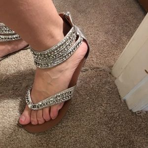 Pretty silver bling ankle strap sandal.  Zip back
